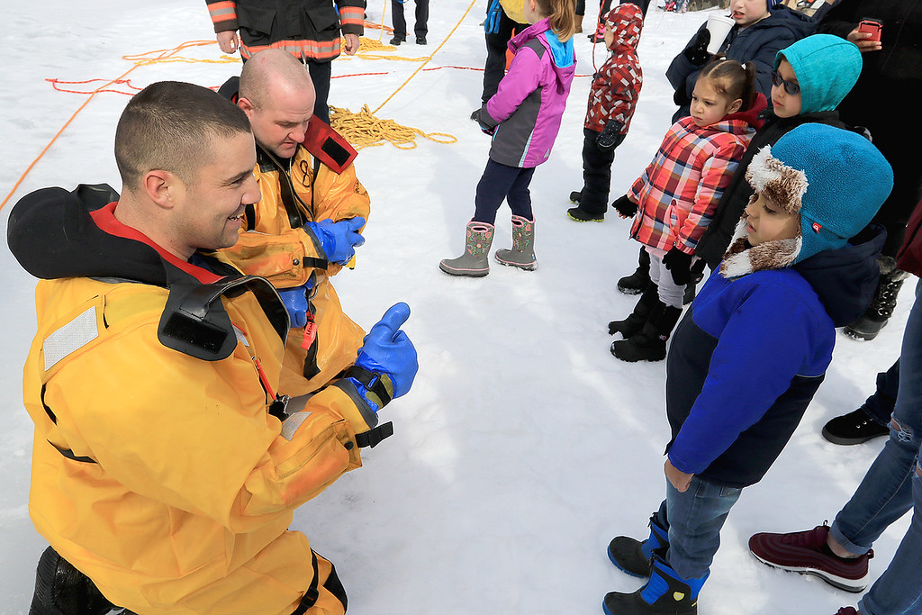 . The Leominster Recreation Department, Project Apples, Growing Places, Leominster Trail Stewards, Emergency Management, the Fire Department and the Boy Scouts joined together to offer a free winter event on Saturday, February, 23, 2019 at Barrett Park. During the event the Leominster Fire Department with Emergency Management held an ice saftey and ice rescue demonstration on Colburns Reservoir at the park. Andre Rodriguez , 4 in blue jacket, of Leominster chats with Firefighter Jon Williams after their ice rescue demonstration. With Williams is Firefighter Adam Studham. SENTINEL & ENTERPRISE/JOHN LOVE