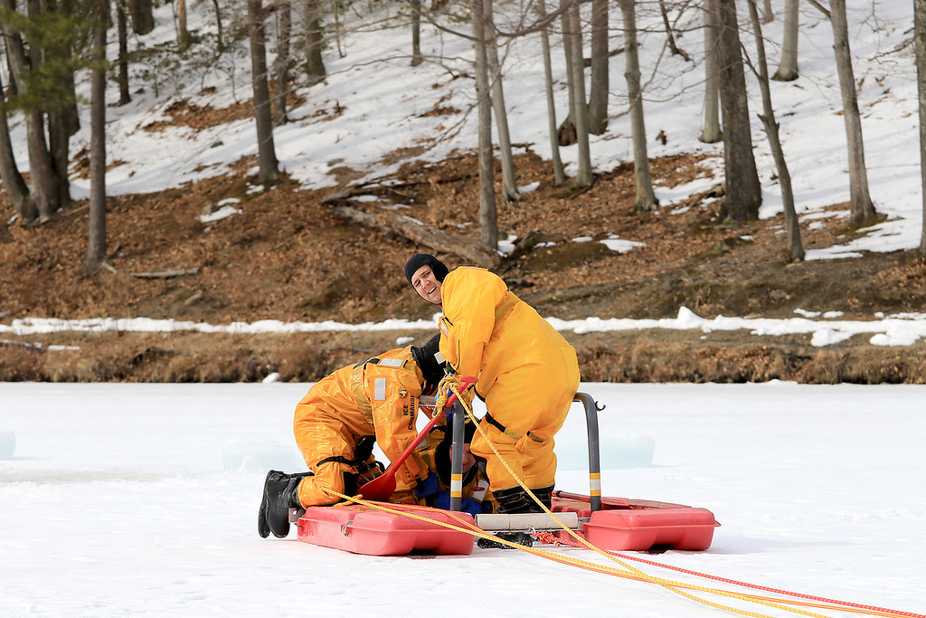 . The Leominster Recreation Department, Project Apples, Growing Places, Leominster Trail Stewards, Emergency Management, the Fire Department and the Boy Scouts joined together to offer a free winter event on Saturday, February, 23, 2019 at Barrett Park. During the event the Leominster Fire Department with Emergency Management held an ice saftey and ice rescue demonstration on Colburns Reservoir at the park. Firefighter Jon Williams, looking back, and Firefighter Jeremy Murphy show how they rescue Firefighter Adam Studham from a hole in the ice. SENTINEL & ENTERPRISE/JOHN LOVE