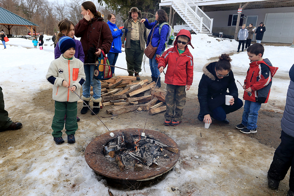 . The Leominster Recreation Department, Project Apples, Growing Places, Leominster Trail Stewards, Emergency Management, the Fire Department and the Boy Scouts joined together to offer a free winter event on Saturday, February, 23, 2019 at Barrett Park. During the event the Leominster Fire Department with Emergency Management held an ice saftey and ice rescue demonstration on Colburns Reservoir at the park. The Leominster Boy scouts from Troop 11 had built a small bonfire for everyone to be able to stay warm and roast marshmallows. SENTINEL & ENTERPRISE/JOHN LOVE