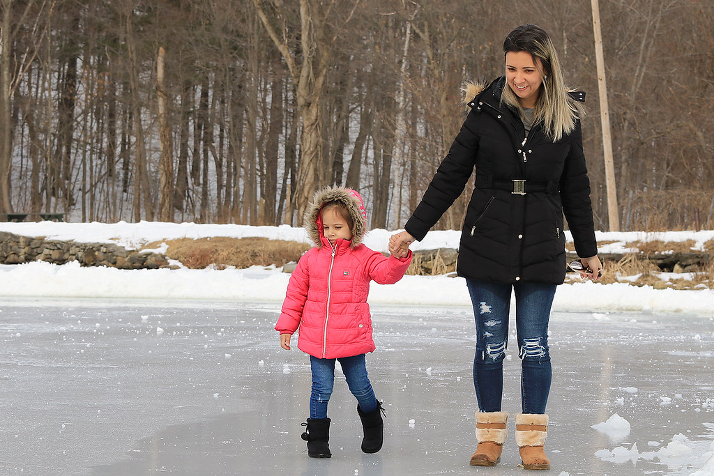 . The Leominster Recreation Department, Project Apples, Growing Places, Leominster Trail Stewards, Emergency Management, the Fire Department and the Boy Scouts joined together to offer a free winter event on Saturday, February, 23, 2019 at Barrett Park. During the event the Leominster Fire Department with Emergency Management held an ice saftey and ice rescue demonstration on Colburns Reservoir at the park. Trying out the ice on the reservoir is Leticia Rachadel, 3, and her mom Jessica Rachadel of Leominster. SENTINEL & ENTERPRISE/JOHN LOVE