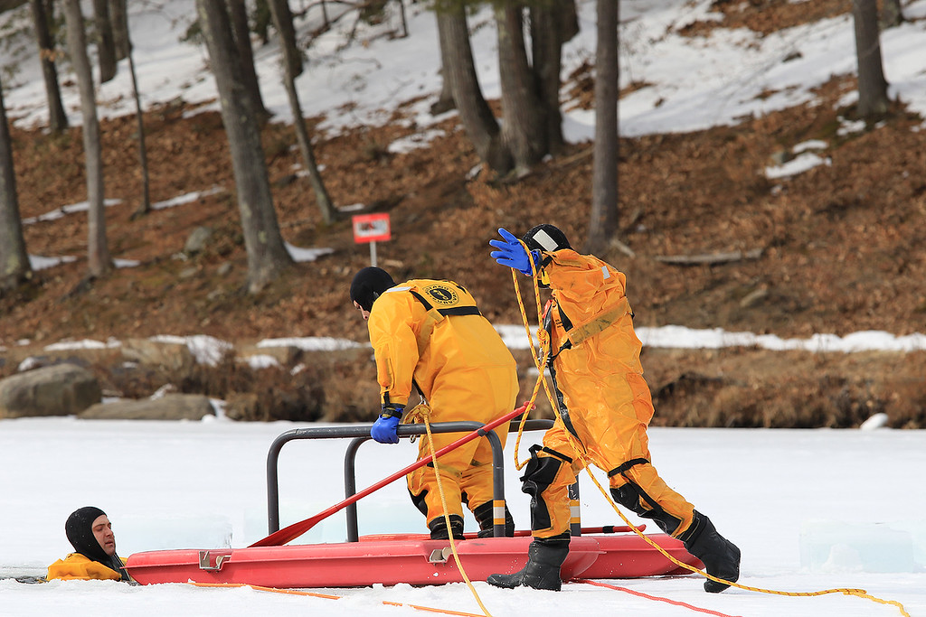 . The Leominster Recreation Department, Project Apples, Growing Places, Leominster Trail Stewards, Emergency Management, the Fire Department and the Boy Scouts joined together to offer a free winter event on Saturday, February, 23, 2019 at Barrett Park. During the event the Leominster Fire Department with Emergency Management held an ice saftey and ice rescue demonstration on Colburns Reservoir at the park. Firefighter Jon Williams heads on on the ice with their ice rescue sled during the demonstration. He is joined by Firefighter Jeremy Murphy with rope as they show how they rescue Firefighter Adam Studham, in water. SENTINEL & ENTERPRISE/JOHN LOVE
