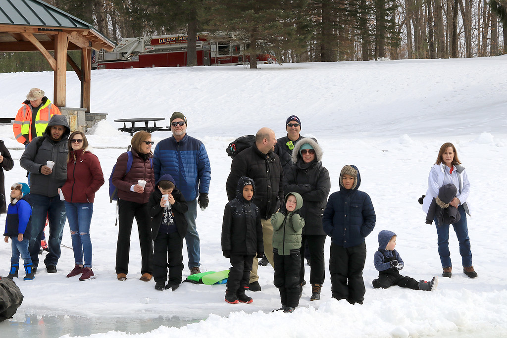 . The Leominster Recreation Department, Project Apples, Growing Places, Leominster Trail Stewards, Emergency Management, the Fire Department and the Boy Scouts joined together to offer a free winter event on Saturday, February, 23, 2019 at Barrett Park. During the event the Leominster Fire Department with Emergency Management held an ice saftey and ice rescue demonstration on Colburns Reservoir at the park. Many watch the demonstration of an ice rescue. SENTINEL & ENTERPRISE/JOHN LOVE