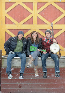 Tania Barricklo-Daily Freeman                      Ruthy Ungar, center and Mike Merenda , right, sit with musician Dan Bern one of hte featurewd musicians  who will be performing Saturday at the Winter Hoot.