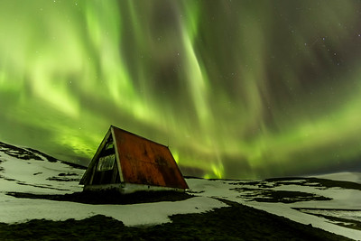 Red Roof Cabin under the Northern Lights