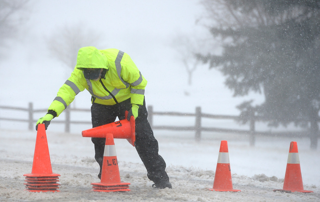 . LONGMONT, CO - MARCH 13:  Longmont Emergency Unit volunteer Steve Heitstuman sets out cones on Ninth Avenue, at Wade Road, during the blizzard March 13, 2019. A utility pole had broken west of the intersection. To view more photos visit timescall.com. (Photo by Lewis Geyer/Staff Photographer)