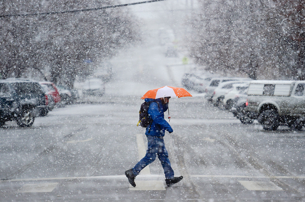 . BOULDER, CO - MARCH 13:Sachin Muralidhara, of Boulder, jogs across 14th Street through the snow in Boulder on March 13, 2019. Today\'s forecast calls for cloudy skies with a high of 36 and 4 to 8 inches of snow with winds 28 to 33 mph with gusts as high as 55 mph.  (Photo by Matthew Jonas/Staff Photographer)