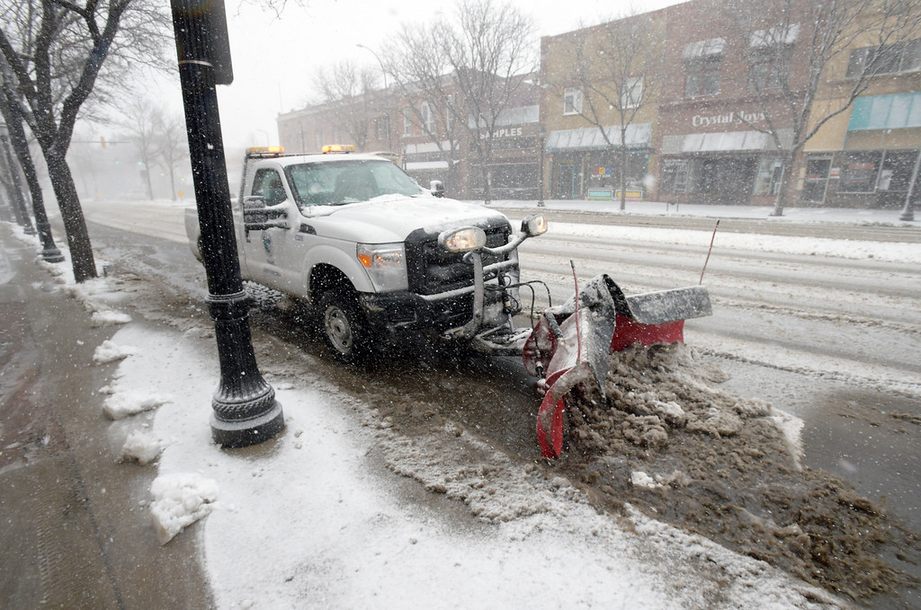 . LONGMONT, CO - MARCH 13: Main Street is plowed during the blizzard March 13, 2019. To view more photos visit timescall.com. (Photo by Lewis Geyer/Staff Photographer)