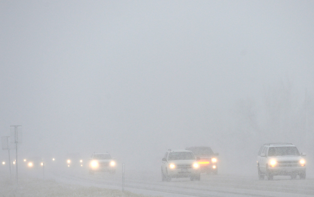 . LONGMONT, CO - MARCH 13: Traffic on U.S. 287 drives into the blizzard north of Longmont March 13, 2019. To view more photos visit timescall.com. (Photo by Lewis Geyer/Staff Photographer)