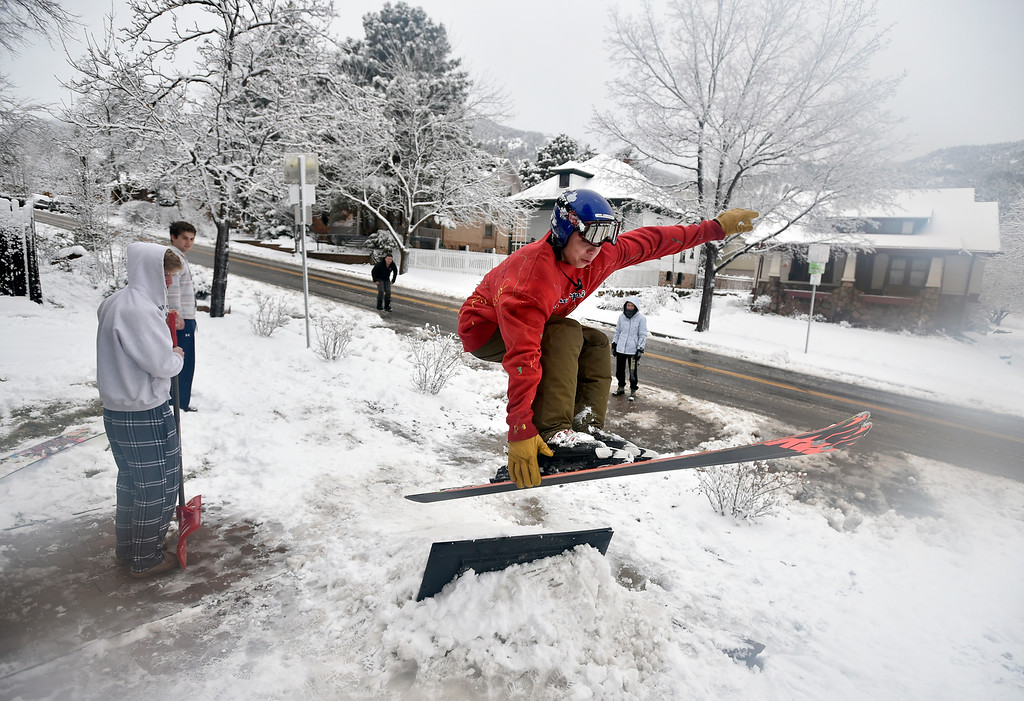 . BOULDER, CO - MARCH 13, 2019: University of Colorado sophomore Gabriel Gomez hits a jump on his skis in front of his house on 9th Avenue during a snowstorm on Wednesday in Boulder. For more photos of the snowstorm go to dailycamera.com  (Photo by Jeremy Papasso/Staff Photographer)