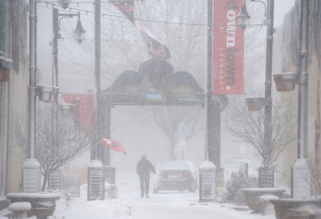 . LONGMONT, CO - MARCH 13: A pedestrian walks through the East Breezeway in the 300 block of Main Street during the blizzard March 13, 2019. To view more photos visit timescall.com. (Photo by Lewis Geyer/Staff Photographer)