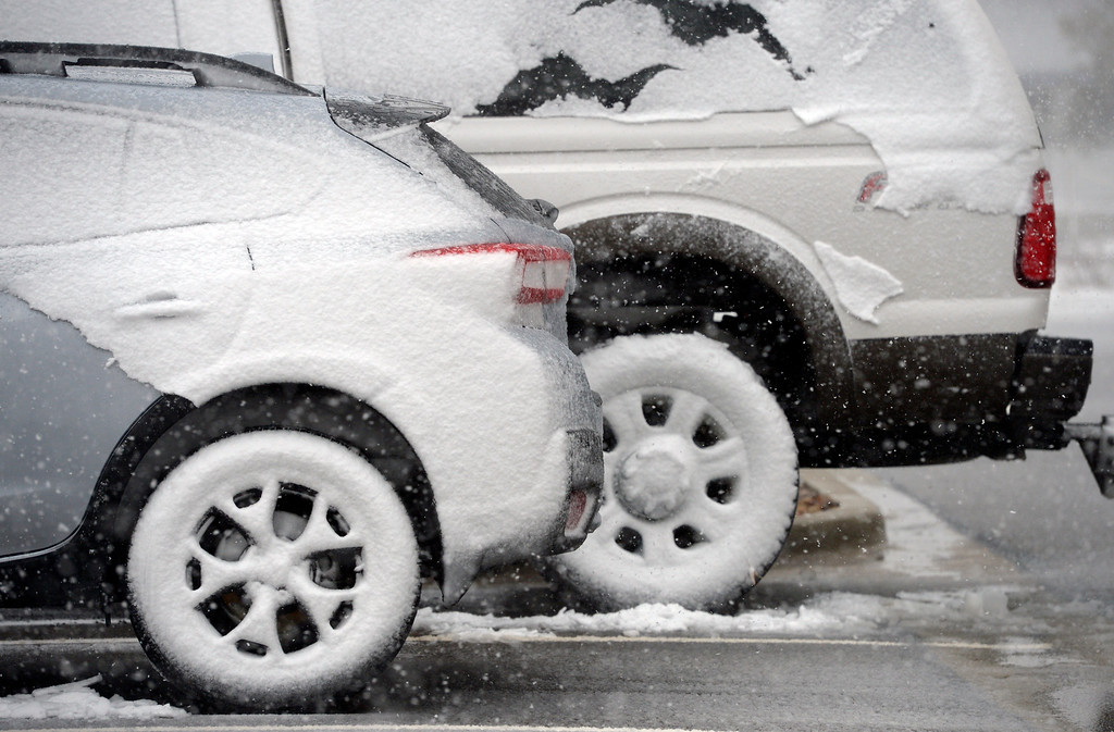 . LONGMONT, CO - MARCH 13: Snow is packed on the north side of cars during the blizzard March 13, 2019. To view more photos visit timescall.com. (Photo by Lewis Geyer/Staff Photographer)