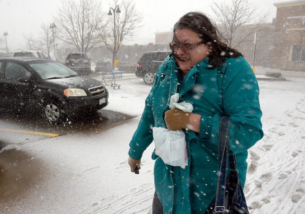 . LONGMONT, CO - MARCH 13: Terri Mackenzie walks to her car after shopping at the Walmart in north Longmont during the blizzard March 13, 2019. To view more photos visit timescall.com. (Photo by Lewis Geyer/Staff Photographer)