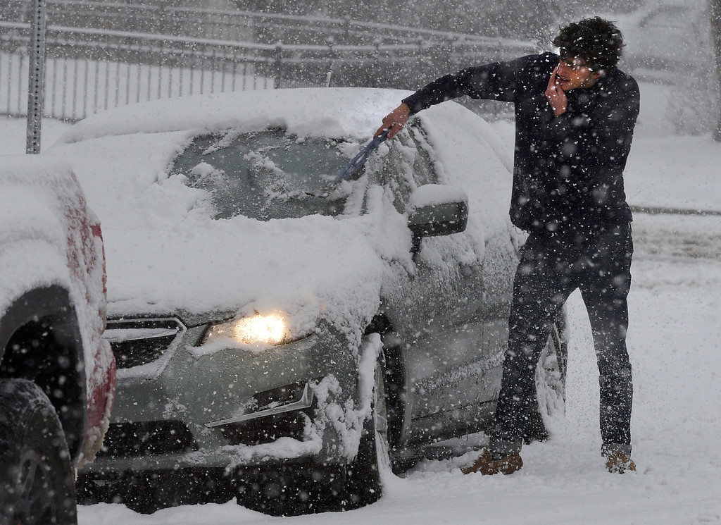 . BOULDER, CO - March 13, 2019:  Daniel Metmed, a CU student, clears the snow from his car on 11th Street during a heavy snow storm in Boulder. For more photos, go to dailycamera.com. (Photo by Cliff Grassmick/Staff Photographer)
