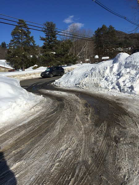 Snow banks were so high that getting out of the parking lot was a challenge