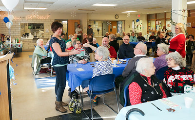 Canton Senior Center Claire Cote, director of Senior and Social Services, and attendees  pick door prize winners at the 2016 Winter Wonderland.  Photo by John Fitts