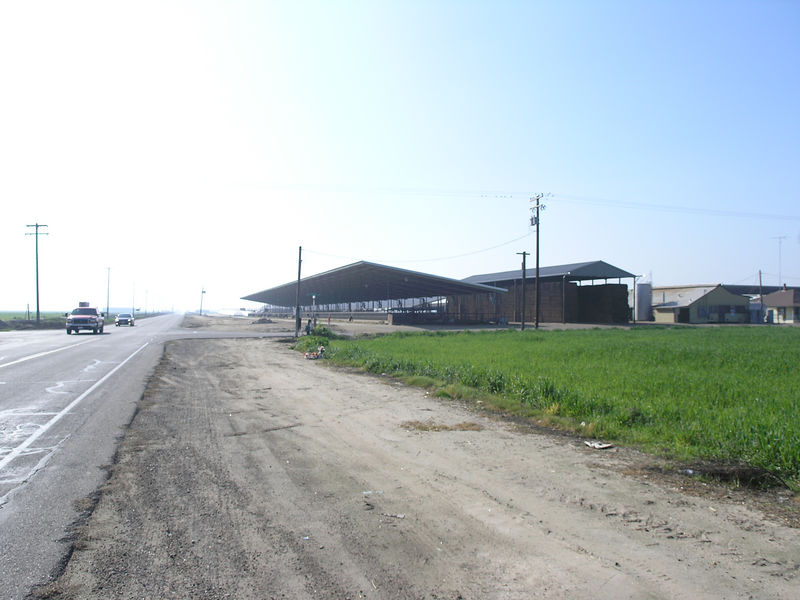A view of the front barn with a hay barn behind.