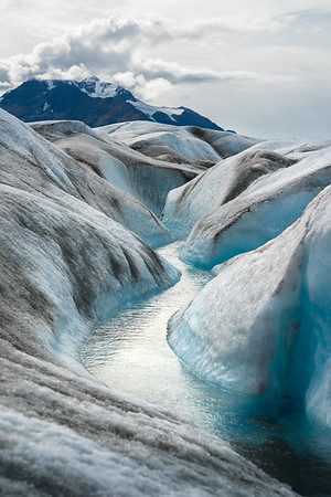 An icy river on the Knik Glacier, Alaska.