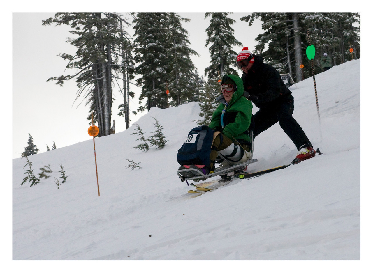 Tyler Ecklund takes his third run of the day with Oregon Adaptive Sports president Kendall Cook.