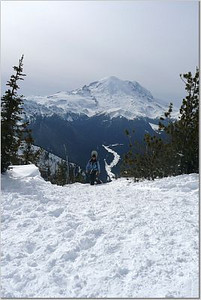 Jesse on the home stretch to the summit with Mount Rainier in the background