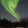 The aurora borealis lights up the night sky off Chena Hot Springs Road near Fairbanks, Alaska.