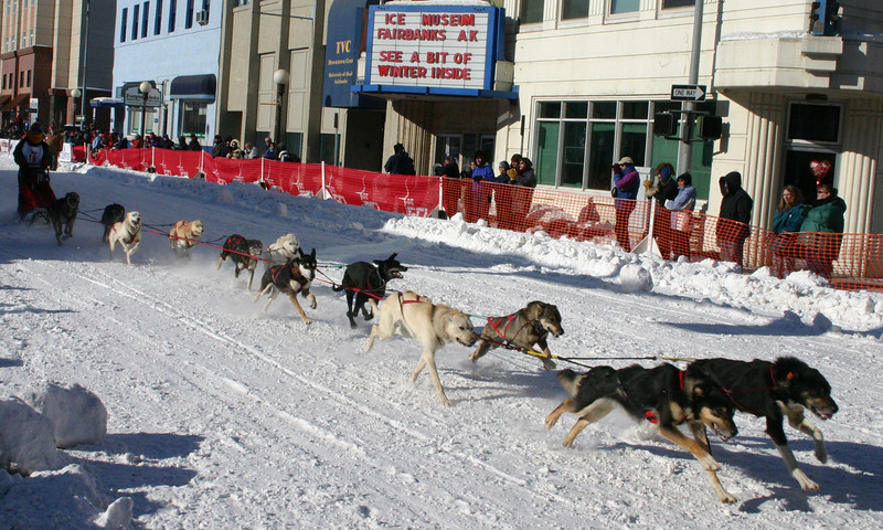 Credit: FCVB/Jade Frank<br /> <br /> A dog team races down 2nd Avenue in downtown Fairbanks during the 2007 Open North American Championship Sled Dog Race.