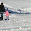 Credit: Jade Frank<br /> <br /> A well-dressed family enjoys a winter stroll together.