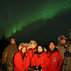 Credit: FCVB<br /> <br /> A group of visitors poses for a photo opportunity with the northern lights.