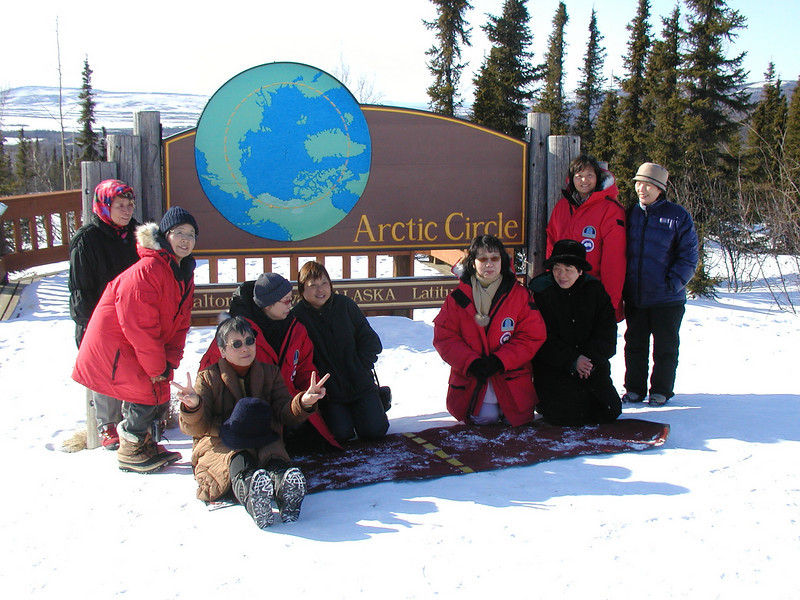 Credit: Northern Alaska Tour Company<br /> <br /> A tour takes advantage of a photo opportunity at the Arctic Circle.