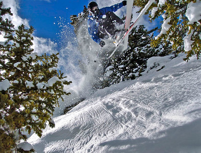 "February 18, 2007; Berthoud Pass, CO, USA;  Local ripper Kris ""Flipper"" Knippert narrowly avoids decapitating a lensman while flying through the trees in the Berthoud Pass backcountry."