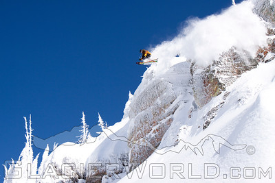 Skier jumps a Cliff at Whtefish Mountain Resort