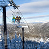 Skiers on Chairlift at Whitefish Mountain Resort.