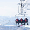 Three Ski Patrolers ride the lifts at Whitefish Mountain Resort