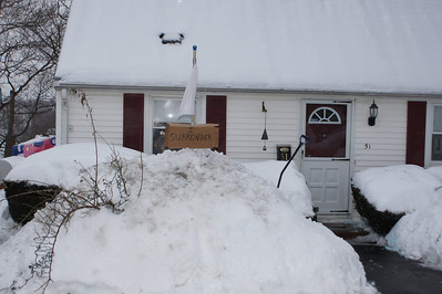 Throwing in the Towel: I give up...We've had over 6 feet of snow during the last 4 weeks. We're averaging 1-2 storms A WEEK! I knocked this snow bank from 8 feet high to 2 feet high last Saturday, but you'd never know - after the two storms we had yesterday and the day before, they're back. The score: Mother Nature - 2....Ed - 0.