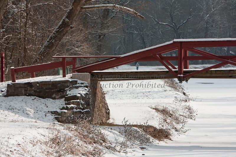 Washington Crossing Pedestrian Bridge and Walker in Snow, Bucks County, PA