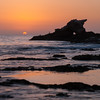 Setting sun and Arch rock
