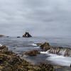 Wave cascading over rocks in Little Corona