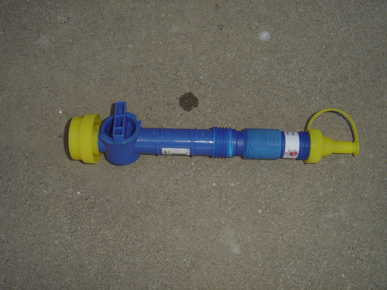 This is a spout and flexible tube that can be used to add anti-freeze to the fresh water tank.