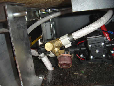 After anti-freeze has been added to the PUP, remove the  plastic line and replaced it with a cap.  Turn the valve to connect the pump with the fresh water tank.