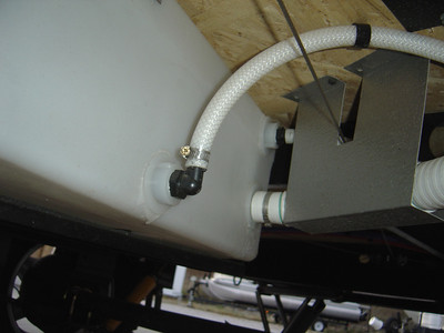 "The third way to add Anti-freeze is to use the pump inlet line.  This is the 1/2"" diameter, translucent, water line at the bottom of the fresh water holding tank.  It  runs up to the 12 volt pump. Remove the water line by loosening the clamp or hose clip."