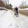 KRISTOPHER RADDER — BRATTLEBORO REFORMER<br /> Heidi Heger walks her bike up a hill on Putney Road, in Brattleboro, Vt., during a snowstorm on Thursday, Feb. 6, 2020.