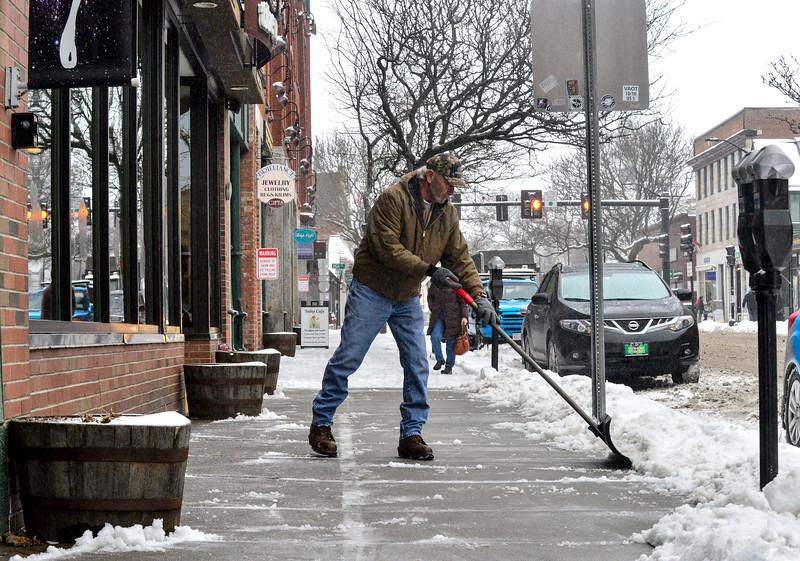 KRISTOPHER RADDER — BRATTLEBORO REFORMER<br /> Gary Smith clears the sidewalk outside of The Works, on Main Street, in Brattleboro, Vt., on Thursday, Feb. 6, 2020.