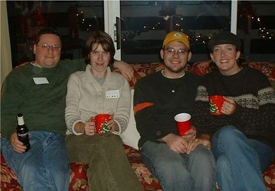 Paul, Jen, Chris, Katie. Chrismas Day, 2003. The day after Chris and Katie were officially engaged! Major announcement! Good Times! Also: it's fun to wear name tags around people you've known forever!