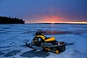 Sunrise out on the frozen surface of Lake Superior.