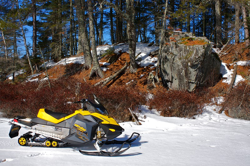 Jumps in the air on commend....dose wheelies down the trail..A one nighter to the North Woods. Found this big rock on an island. First new sled since 93. Plenty of room for the camping gear.