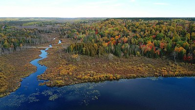 The portage, between the Brule and the St. Croix, linking the Great Lakes to the Mississippi 1680. The portage was used for hundreds of years. The St. Croix and the Brule both start in this blog. The continental divide separates the two. The portage Trail runs on top the bluff to the right.