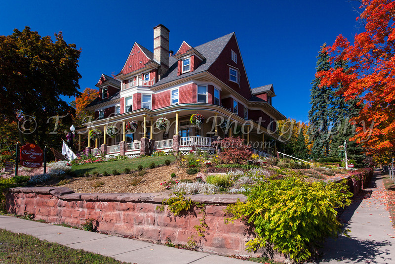 The Rittenhouse Inn mansion with fall foliage color in Bayfield, Wisconsin, USA.
