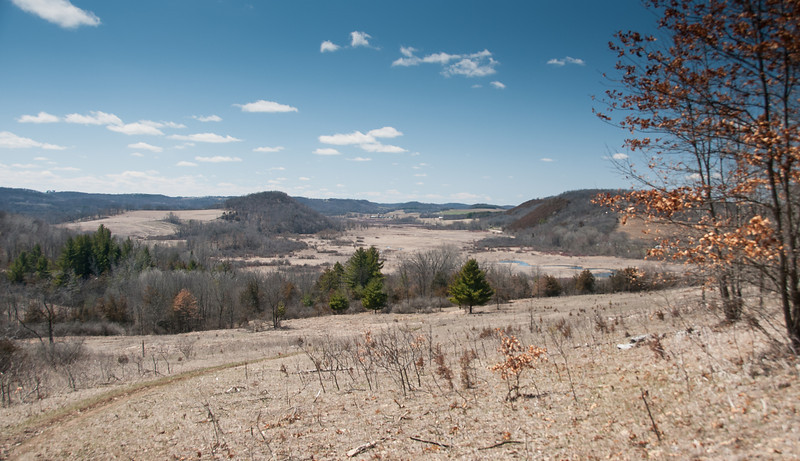 View above Twin Pines of the glacial tunnel channel cut between Center Bluff to the left and Hawk Hill to the right.