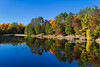 Brilliant fall foliage reflected in Minocqua Lake near Minocqua, Wisconsin, USA.