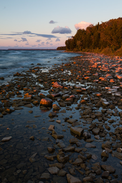 As the sun closes in on the horizon, the warm light bathes the shoreline of Peninsula State Park. Door County, WI<br /> <br /> WI-100904-0138