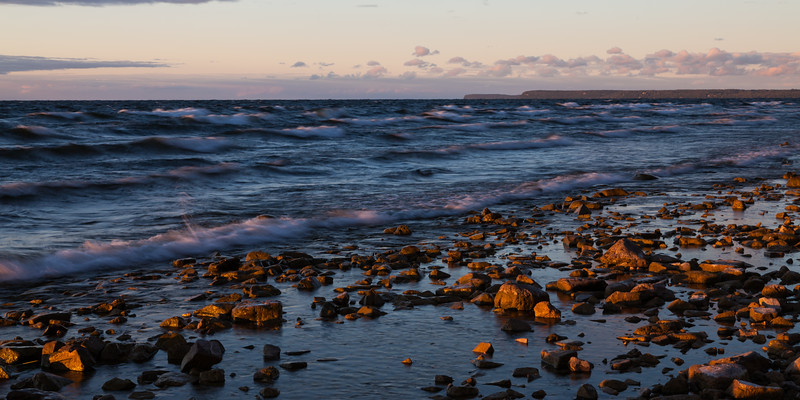 Magenta and orange tones dot the shore line of Peninsula State Park at sunset. Door County, WI<br /> <br /> WI-100904-0117